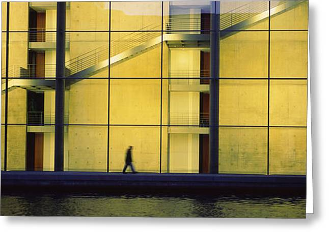 Silhouette Of A Person Walking In Front Greeting Card by Panoramic Images