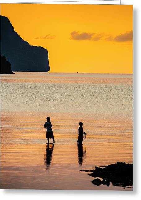 Silhouette Of Boys Fishing At Sunset Greeting Card by Michael Runkel