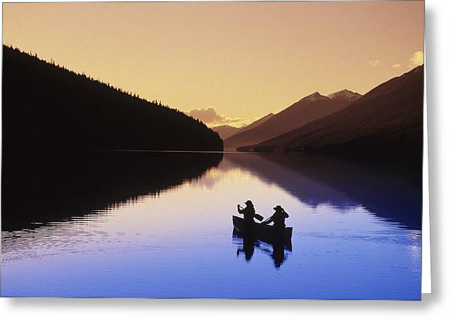 Silhouette Of Canoeists, Bowron Lake Greeting Card by Chris Harris