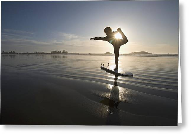 Silhouette Of Female Surfer Doing Bow Greeting Card by Deddeda