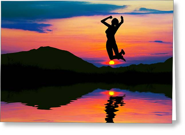 Silhouette Of Happy Woman Jumping At Sunset Greeting Card