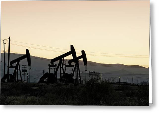 Silhouette Of Oil Rigs At Sunset Greeting Card