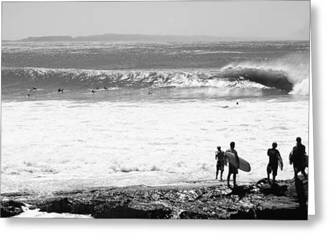 Silhouette Of Surfers Standing Greeting Card