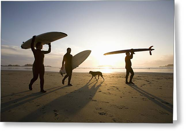 Silhouette Of Three Surfers And A Dog Greeting Card
