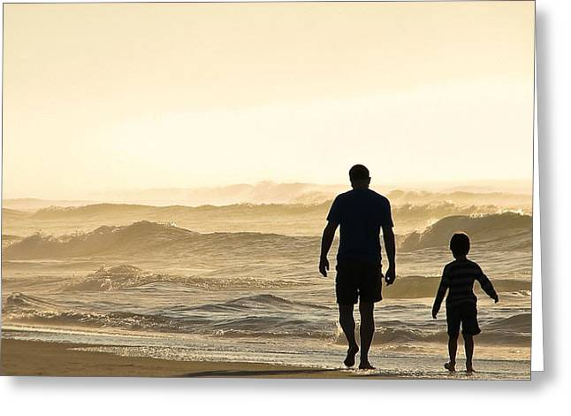 Silhouetted Father And Son Walk Beach  Greeting Card