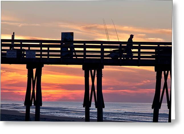 Silhouetted Fisherman On Ocean Pier At Sunrise Greeting Card