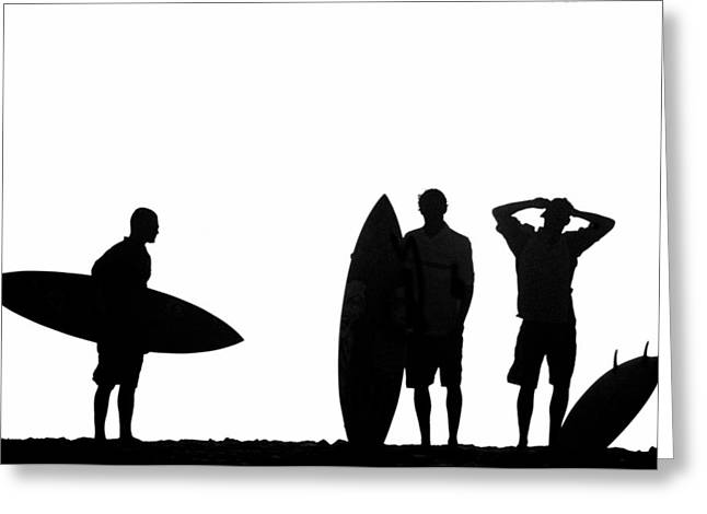 Silhouetted Surfers Greeting Card by Sean Davey