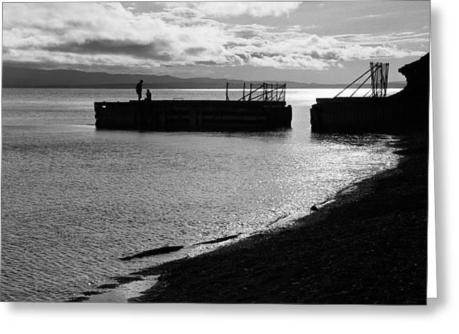 Silhouettes On Broken Pier Greeting Card by Arkady Kunysz