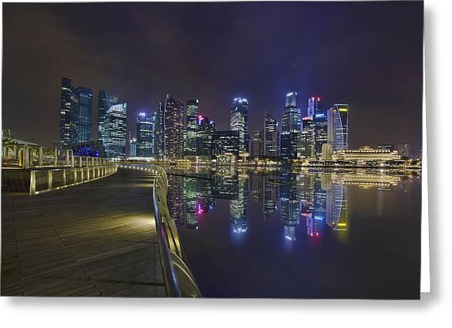 Singapore City Skyline Along Marina Bay Boardwalk At Night Greeting Card by David Gn