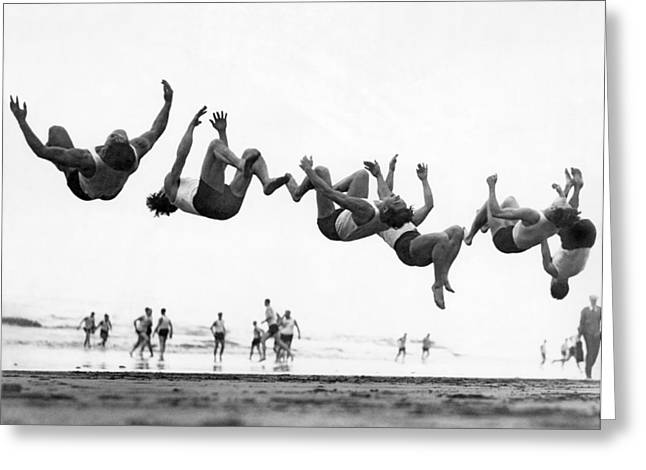 Six Men Doing Beach Flips Greeting Card by Underwood Archives