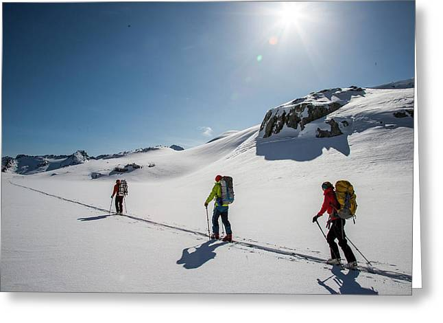Skiers Ascend A Skin Track At The Top Greeting Card
