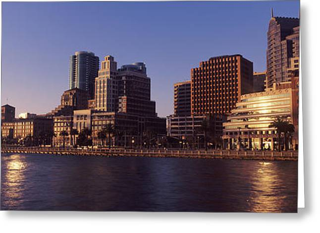 Skyscrapers And Bay Bridge At Sunset Greeting Card by Panoramic Images