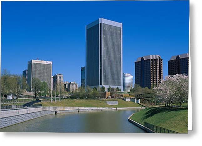 Skyscrapers Near A Canal, Browns Greeting Card by Panoramic Images