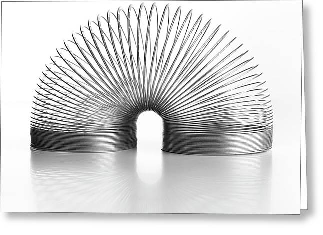 Slinky Spring Greeting Card by Science Photo Library