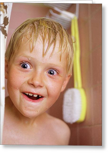 Smiling Wide-eyed Boy Sticking His Wet Greeting Card