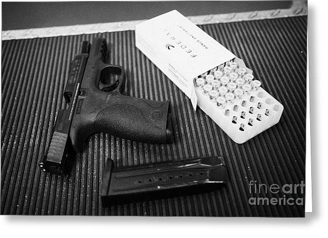Smith And Wesson 9mm Handgun With Ammunition At A Gun Range Greeting Card by Joe Fox