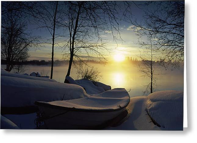 Snow Covered Boats At The Riverside Greeting Card