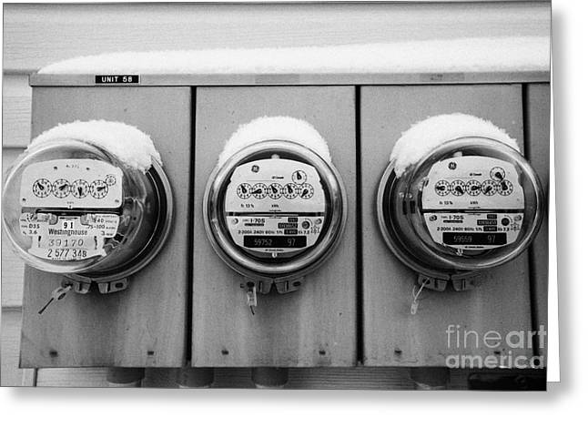 snow covered electricity meters in Saskatoon Saskatchewan Canada Greeting Card