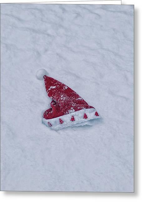 snow-covered Santa hat Greeting Card by Joana Kruse