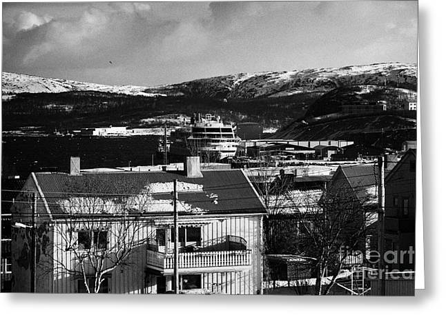 Snow Covered Street Of Traditional Wooden Houses Looking Down To Hurtigruten Ship In Kirkenes Harbou Greeting Card