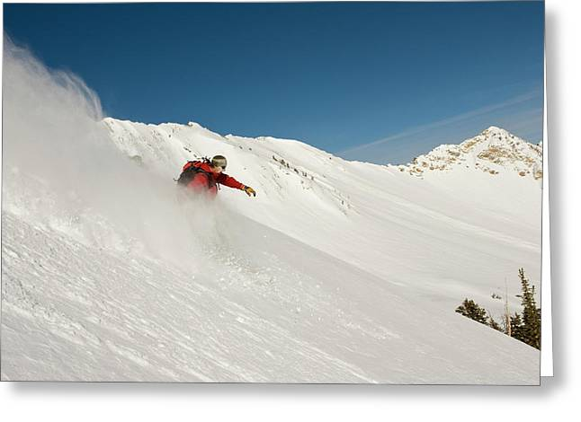 Snowboarder Enjoys The Powder Greeting Card by Howie Garber