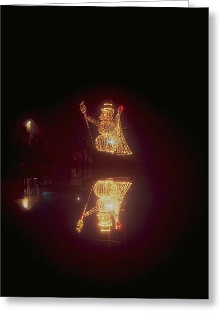 Snowman In Lights Greeting Card by Eb Guenther