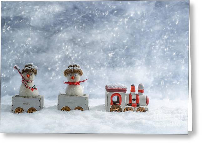 Snowmen In Train Greeting Card by Amanda Elwell