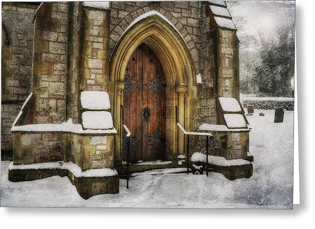 Snowy Church Door Greeting Card by Ian Mitchell