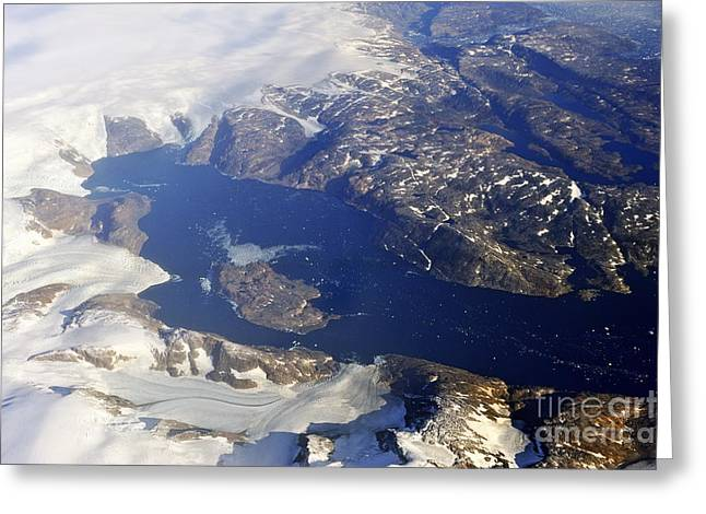 Snowy Rocky Coastline And Floating Icebergs On Ocean Greeting Card by Sami Sarkis