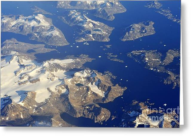 Snowy Rocky Islands And Floating Icebergs On Ocean Greeting Card by Sami Sarkis