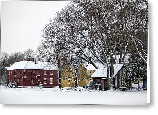 Snowy Village Greeting Card by Eric Gendron