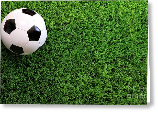 Soccer Ball On Green Grass Greeting Card by Sandra Cunningham
