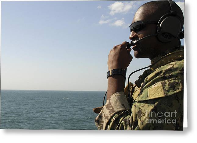 Soldier Instructs Small Boat Maneuvers Greeting Card by Stocktrek Images
