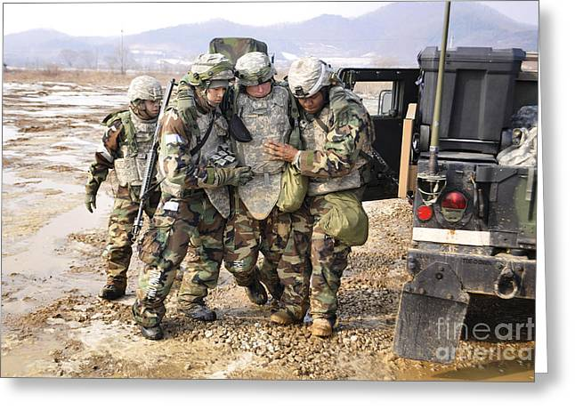 Soldiers Conduct Medical Evacuation Greeting Card by Stocktrek Images