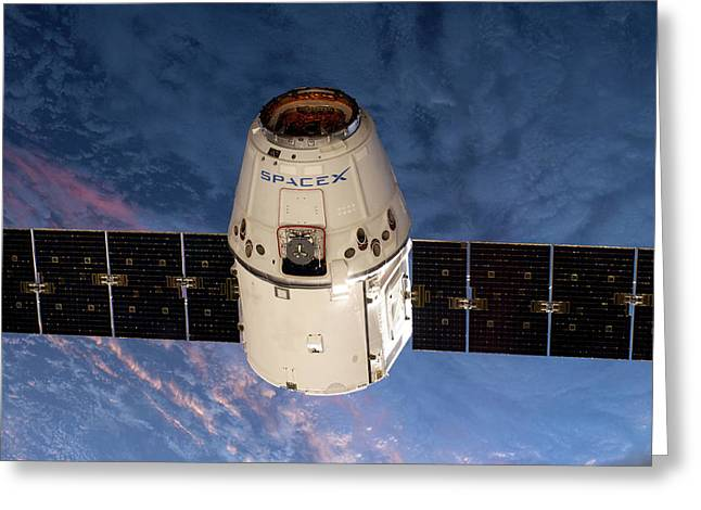 Spacex Dragon Capsule At The Iss Greeting Card by Nasa