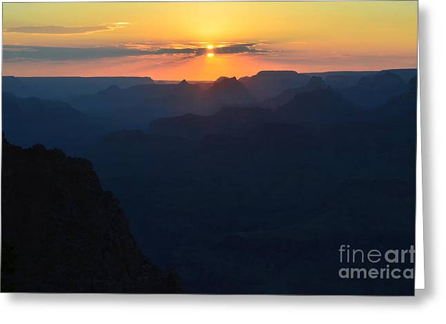 Split Sun Orange Sunset Twilight Over Silhouetted Spires In Grand Canyon National Park Greeting Card by Shawn O'Brien