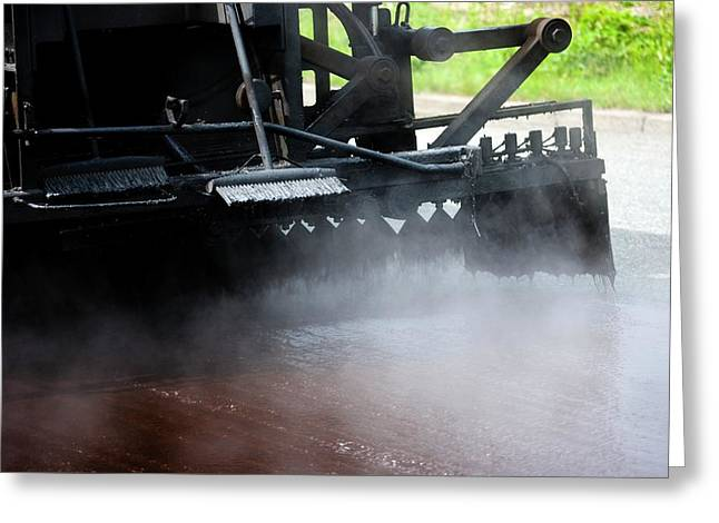Spraying Bitumen During Road Resurfacing Greeting Card by Ian Gowland/science Photo Library