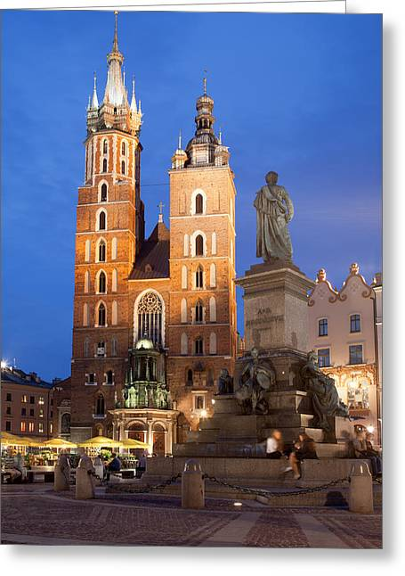 St Mary Basilica And Adam Mickiewicz Monument At Night In Krakow Greeting Card by Artur Bogacki