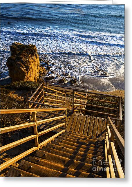 Greeting Card featuring the photograph Steps To Blue Ocean And Rocky Beach by Jerry Cowart