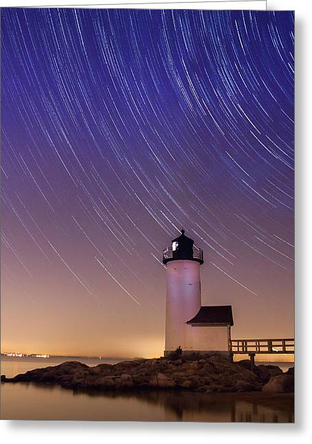Greeting Card featuring the photograph Stars Trailing Over Lighthouse by Jeff Folger