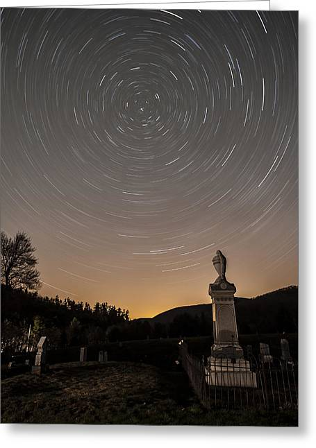 Stars Trails Over Cemetery Greeting Card by Susan Candelario