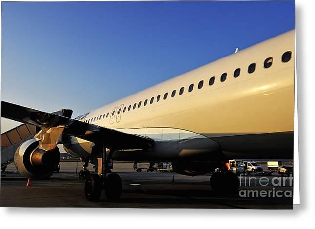 Stationary Airplane On Tarmac At Sunrise Greeting Card by Sami Sarkis