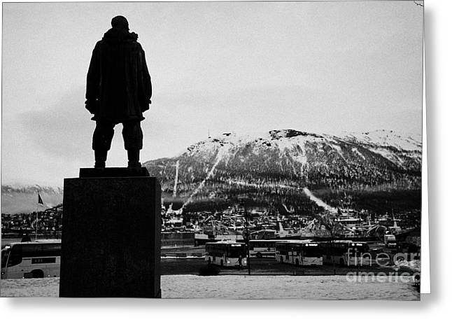 statue of adventurer roald amundsen looks out over Tromso harbour and  floya mountain troms Norway e Greeting Card by Joe Fox