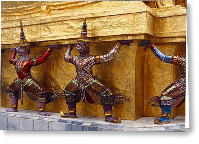 Statues At Base Of Golden Chedi, The Greeting Card by Panoramic Images