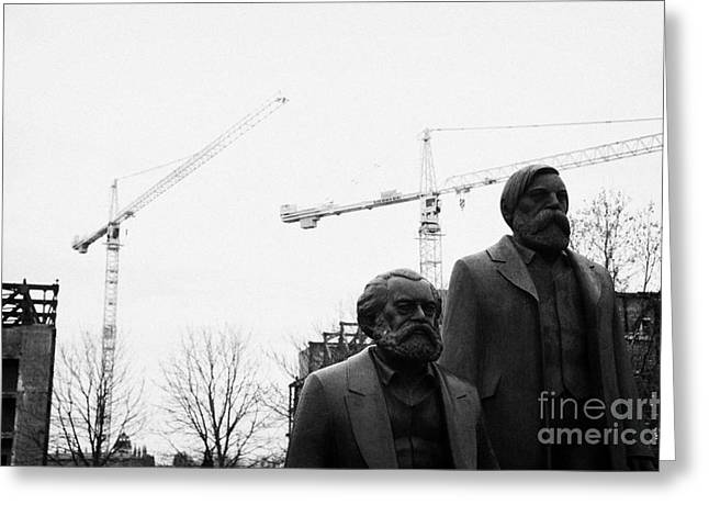 statues of marx and engels with deconstruction of the palast der republik in the background Berlin Germany Greeting Card by Joe Fox