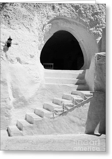 steps up to the entrance of one of the caves at the Sidi Driss Hotel underground at Matmata Tunisia scene of Star Wars films vertical Greeting Card