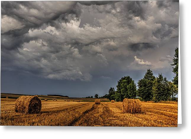 Storm Clouds Over Harvested Field In Poland 2 Greeting Card
