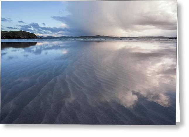 Stormy Skies Reflecting In The Sand Greeting Card by Peter McCabe