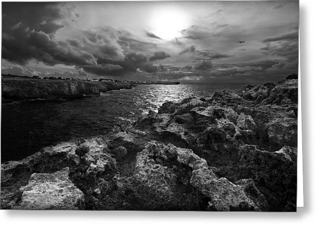Blank And White Stormy Mediterranean Sunrise In Contrast With Black Rocks And Cliffs In Menorca  Greeting Card by Pedro Cardona