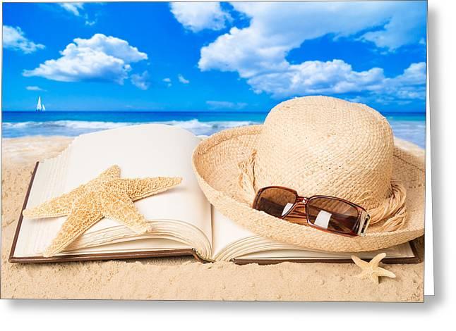 Straw Hat On Beach Greeting Card by Amanda Elwell